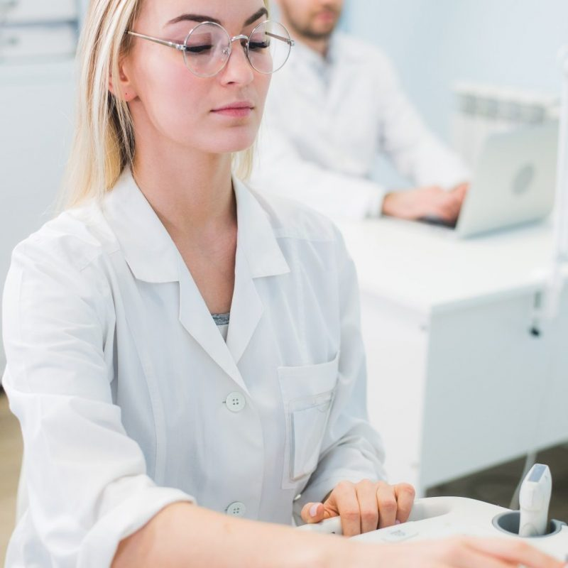 cheerful-young-researchers-are-working-in-lab